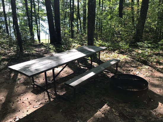 """Boulder Junction, WI: One of the campsites here at """"Indian Mounds"""" with picnic table, fire-ring and a path down the hill to Tomahawk Lake"""