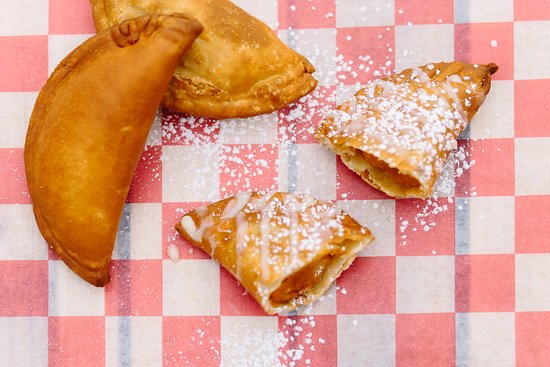This is our Pumpkin Pie Empanada: (SEASONAL ONLY: Oct-Dec)  made with 100% roasted pumpkins (not scooped from a can), nutmeg, cinnamon, pumpkin spice, sugar, etc. Then fried to perfection, drizzled with caramel sauce, pumpkin flavored condensed milk and powdered sugar. Pure perfection. Contains:egg, and milk.   'TIS THE SEASON!