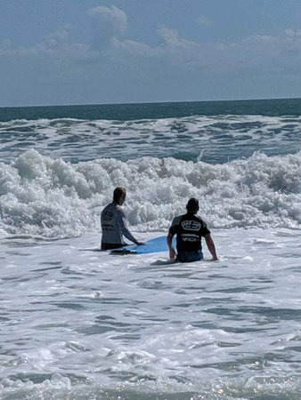 Warren and Ron on their way back out to catch a wave.
