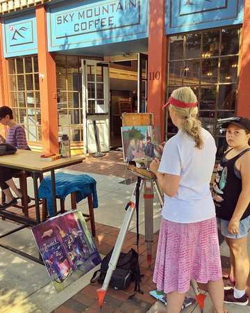 Local artist painting out front.