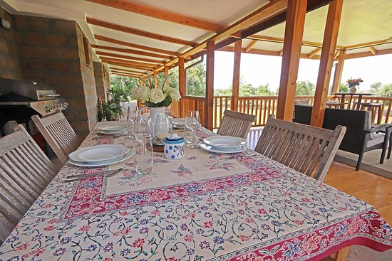 Dinning facilities on the patio off the big fully equipped kitchen.