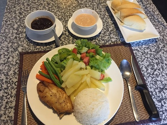 Fish fillet tamarind sauce served with vegetables and rice