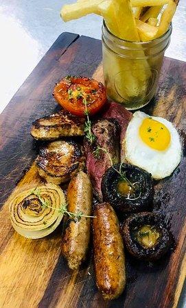 Beef tenderloin, pork tenderloin, Irish sausages, onion, truss tomatoes, portobello mushroom, fried egg, hand-cut fries. Dove & Dragonfly Lounge