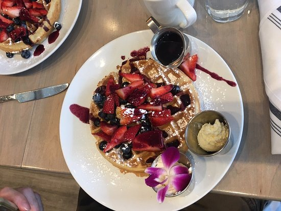Classic Belgian waffles, topped with fresh berries and berry glaze, served with warm Maple syrup, whipped butter and home-made whipped cream