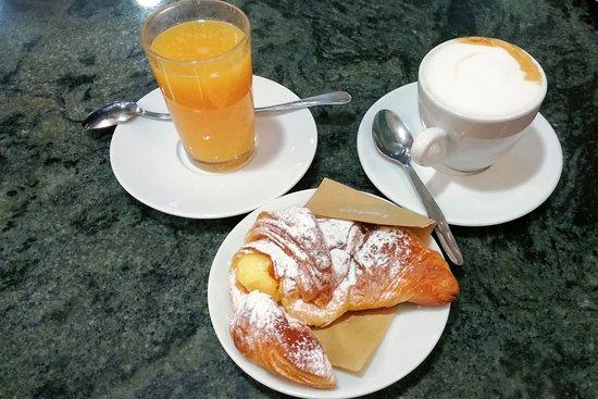 Cappuccino, fresh orange juice and cornetto