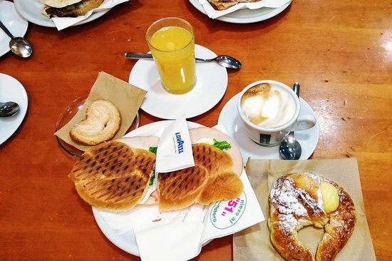 Cappuccino, fresh orange juice, ham and mozzarella panini, cornetto and ventaglio