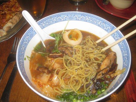Zelienople, PA: Noodle Bowl with noodles, pea shoots, scallions, soy marinated egg, kimchi, shiitake mushrooms.