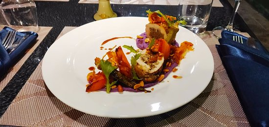 Stuffed poultry with eggplants caviar, purple sweet-potato mash and vegetables.