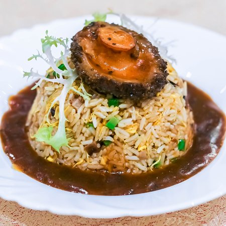 Fried rice topped with a big piece of fresh abalone!