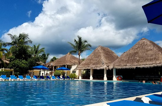Pool view looking at the swim up bar, Allegro Cozumel.