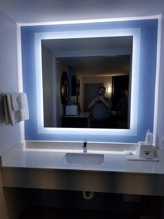 Modern vanity area with nice design.