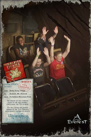 Enjoying Expedition Everest, hands up and laughing, we're all having a great time.