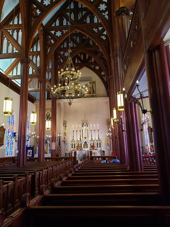 Beautiful alter and unique pews with small gate doors.