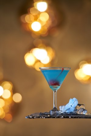 Aero Tini - the signature cocktail! Mixture of Gordon Gin with Drizzle of Blue Curacao accinoabued with refreshing Pineapple Juice.