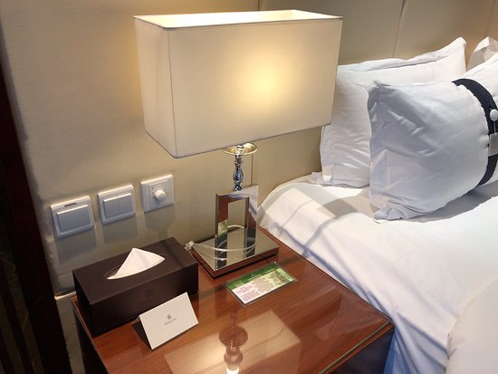 Bedside table in standard double room