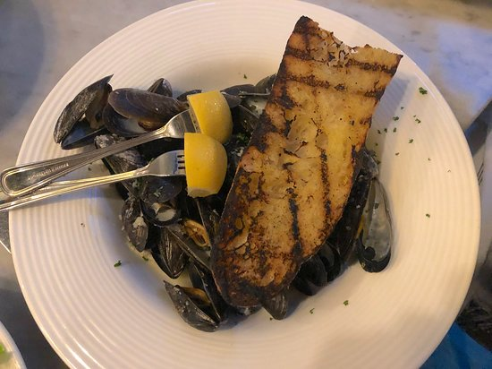 Victoria, MN: The mussels, served with a wedge of grilled bread for soaking up the salty juices.