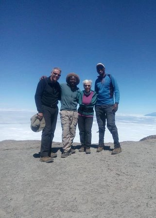 After finishing an invigorating climb up the Barranco Wall on the Machame Route of Kilimanjaro: Chuck, Kambona, Deb and Adamson (left to right)