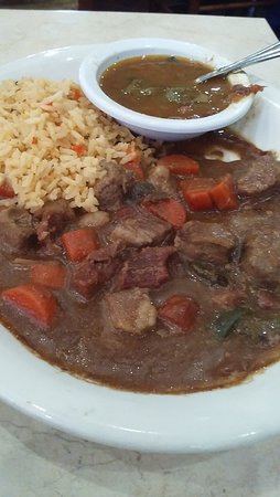 Snook, TX: Lunch Special: Carne Guisada with rice and charro bean.  GARLICKY, and SALTY.