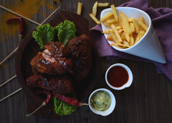 Kazhakkoottam, India: Nashville Fried Chicken . . . Famous American Nashville chicken is here, served with potato wedges, pieces of toasted bread and salad...
