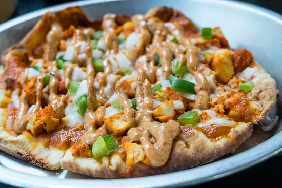Chicken Tikka Flatbread topped with our signature Moti Sauce.