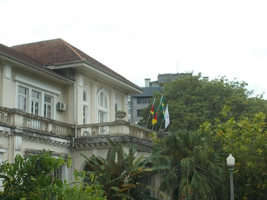 The flags on a balcony of the Building (seen from the garden in front)