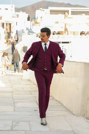 Mr.Sam with his Maroon Color 3-piece suit.