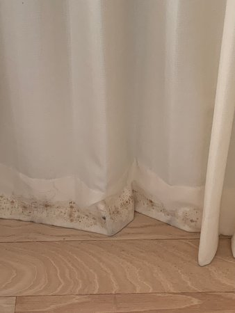 Filthy stained curtains