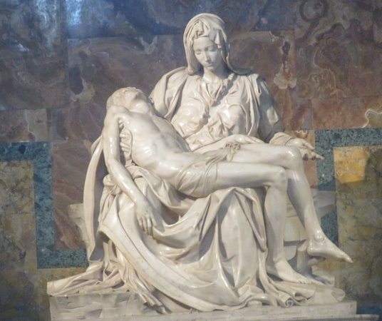 Michelangelo Buonarroti work of art 'The Pieta' sculpture. A Renaissance sculptor masterpiece inside St Peters Basilica, Vatican City, Rome, Italy.
