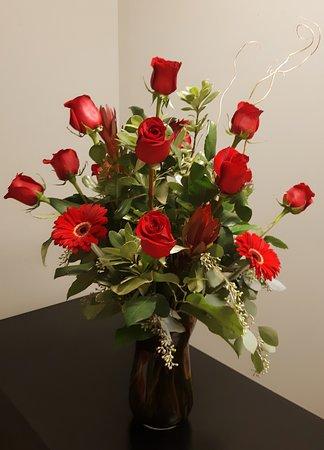Lexington, MO: Dozen Roses and Gerbera Daisies