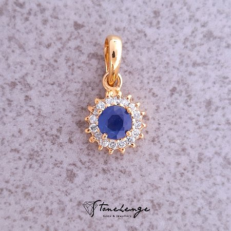 18ct Gold Cluster Pendant Features A Round Blue Sapphire To The Centre, Surrounded By Brilliant Cut Diamonds