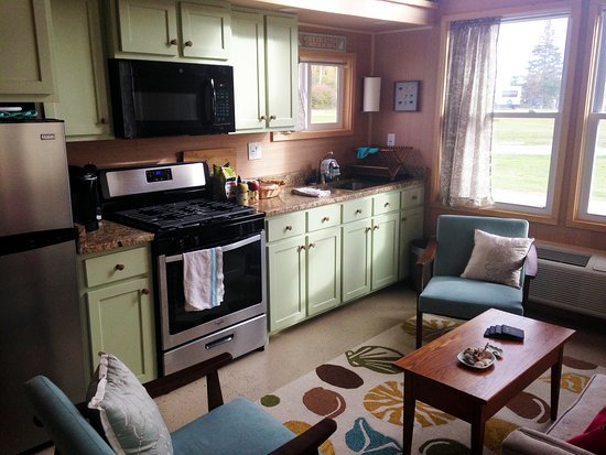 Kitchen and living area with full sized oven, microwave and Kureg Coffee Machine