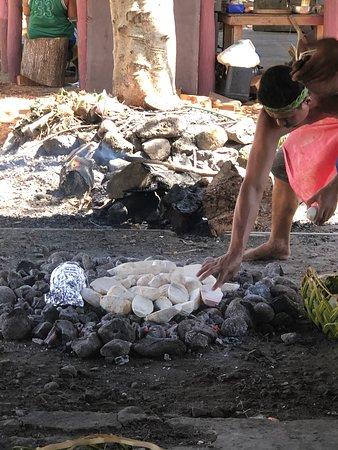 Taro and green bananas on the hot coals
