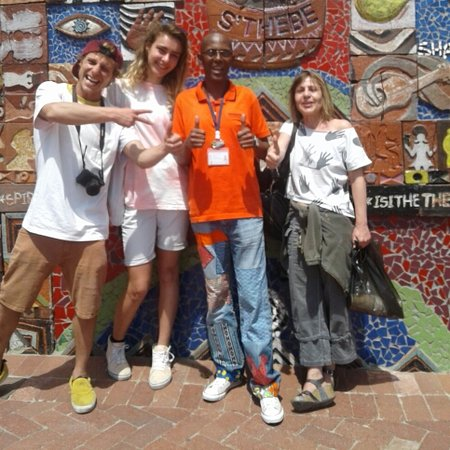 Tourists from France visiting Langa Township  with Cyprian tourist guide from Langa