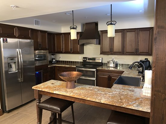 Signature Collection Kitchen in 4-Bedroom Villa. Highlights would be the the double oven and wine fridge and the farmhouse sink!
