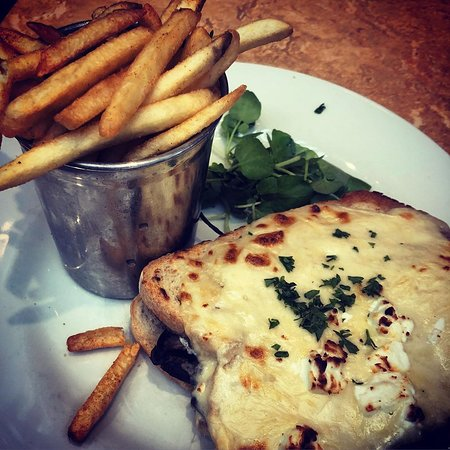 Cribbs Causeway, UK: Croque - classic grilled Emmental cheese sandwich on sourdough with béchamel sauce, served with frites. The filling was Portobello mushroom with baby spinach, goat's cheese and a drizzle of truffle oil.