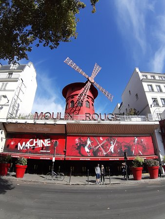 Start the climb into Montmartre next to the Moulin Rouge.
