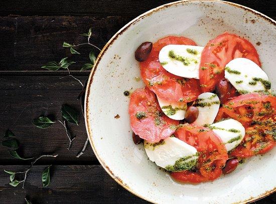 Caprese peeled tomato, mozzarella, kalamata olives, pesto