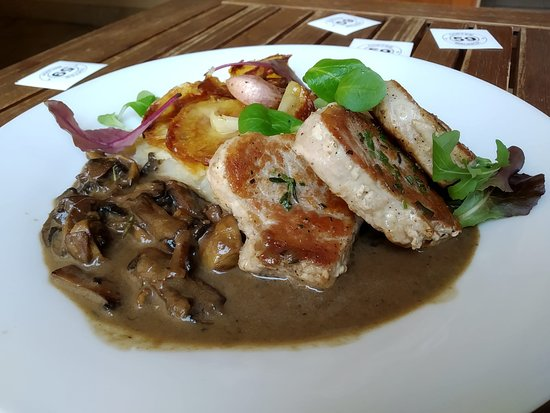 Grilled pork filet with mushroom sauce and baked potatoes