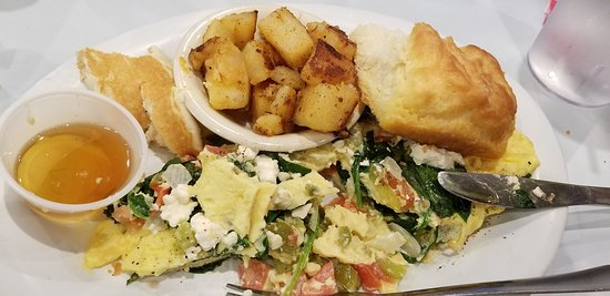 This omelet with feta, peppers and tomato was topped with spinach at my request.  A cup of honey for that huge biscuit!