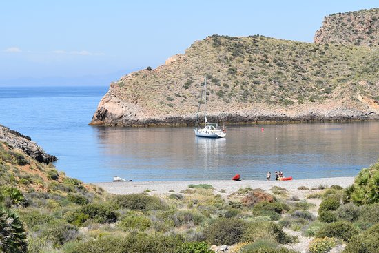 A yacht moored in Cala Cerrada