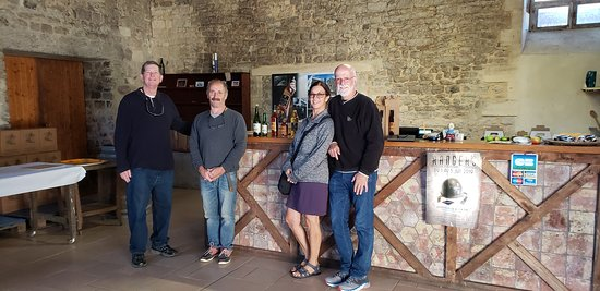 Englesqueville-la-Percee, France: Mr. LeBrec, second from left, inside the tasting room at Maison LeBrec, with some very happy American tourists having enjoyed the tastings.