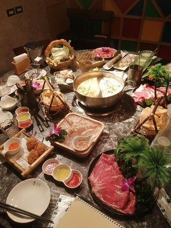 full table of seafood, beef, pork, snacks, vegetable,..and source