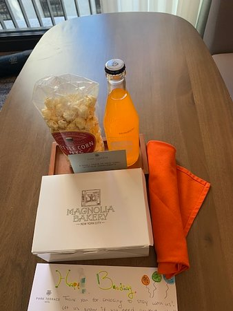 Delightful welcome gift of cupcakes, kettle corn and soda