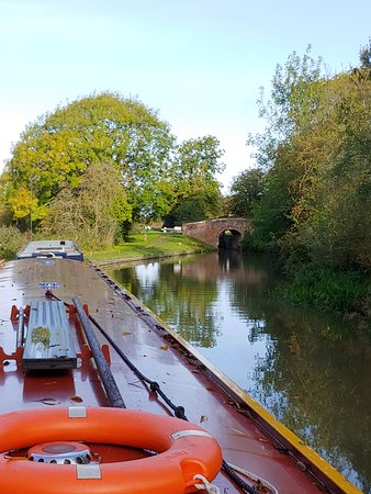 One of many 300 year old stone bridges on the Oxford Canal. Our Narrow Boat in the foreground.