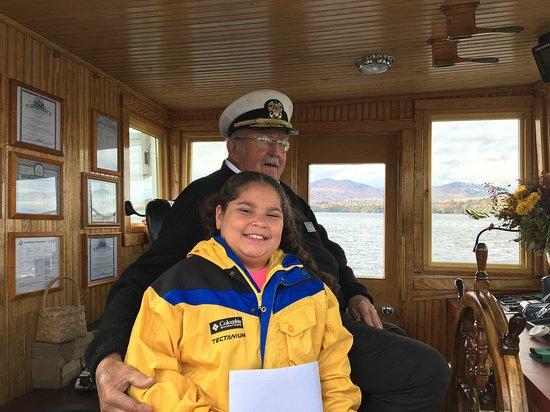 Raquette Lake, NY: Captain  Dean  Pohl  and  Lilyana  on  the  bridge.