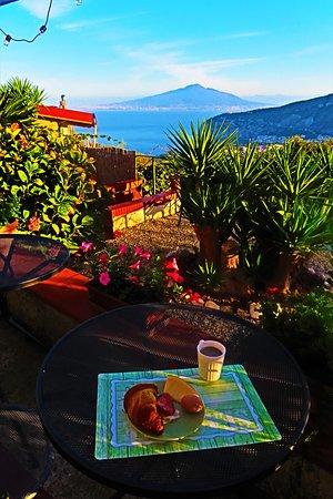 Breakfast on the dramatic patio of Villa Monica B&B