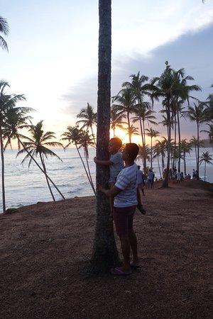 Dankotuwa, Sri Lanka: Janak and my son at the coconut tree hill