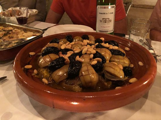 Chicken tagine with stewed apples, dates and almonds. Yum!