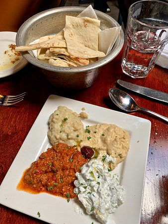 Our fabulous tasting appetizer of Hummus, Tzatziki & Esme and bowl of fresh Pita Bread......so delicious !