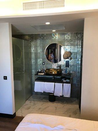 Bathroom in bedroom with toilet on left - NOTE big gap over glass door